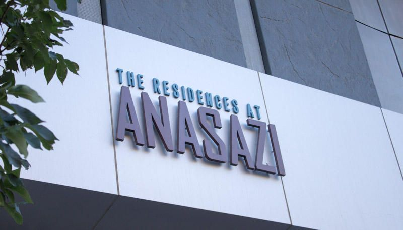Welcome toThe Residencews At Anasazi. One of ABQ's finest Urban Condo Community. Enjoy this units private balcony with views North, East and West, up and down ABQ's famous Route 66. Views of Downtown and the West Mesa. This light filled unit also has remote controlled window shades. Unit owner on site covered assigned parking and secured card key building access. Stainless kitchen appliances, washer/dryer and trash compactor included. All tile throughout. Quartz countertops and vanities. Full height backsplash. Contemporary finishes throughout.