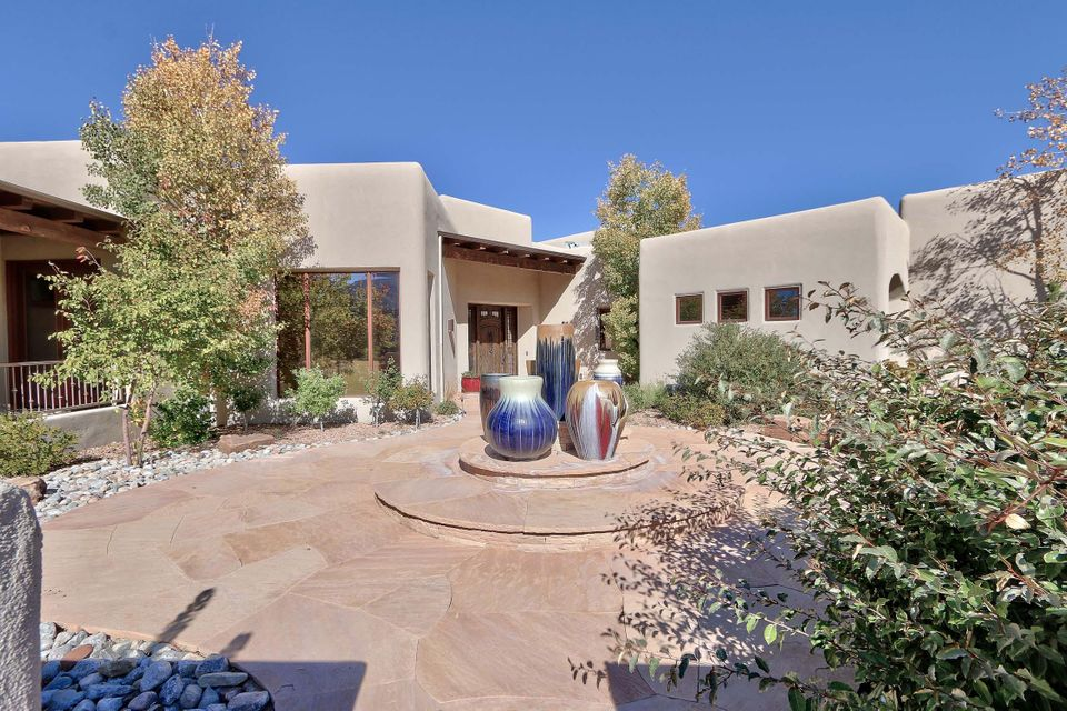 Custom Rutledge built for $2.1 Mil in The Wilderness of High Desert. Gourmet kitchen with island, granite counter tops, Wolf & Sub-Zero appliances, Lg pantry, custom cabinets. Great room-stone fireplace, media wall with 4 TV's,walls of windows w/mountain & city views,wet bar w/Sub-Zero wine cooler, refrigerator, ice maker&espresso machine. Hardwood floors,plaster walls & elevator. Master suite has Lg windows, fireplace, TV, coffee station, granite tub&sinks counter tops, separate shower, California closet system. Office w/built-ins. Covered back patio w/city views,w/Wolf Grill, fire pit, putting green, 2 water features. 4 car garagew/insulated copper doors, workshop, 1/2 bath&storage. Mechanical closet contains radiant heat system, forced gas heater, water softener&tankless hot water system.