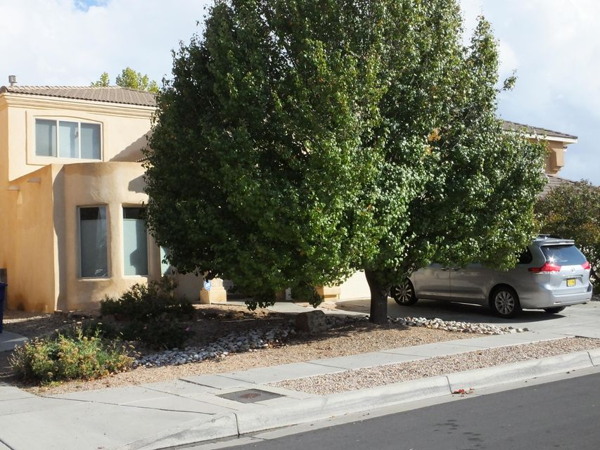 Lots of room in this beautiful home in NE Albuquerque. This home is nice and roomy with wonderful new wood flooring, open kitchen, roomy living areas and large bedrooms. Easy access to the highway, lots of shopping and entertainment close by. Easy commute to  Santa Fe!