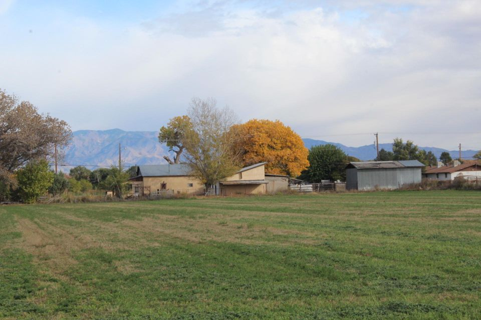Five acres of beautiful irrigated land, with gorgeous views of the Manzano mountains and New Mexico sunsets. Includes a 1 bedroom house that needs TLC, detached 2 car garage, barn, corrals. What a great opportunity to make this your home! Selling in an ''AS IS'' condition. Owner financing will be considered.