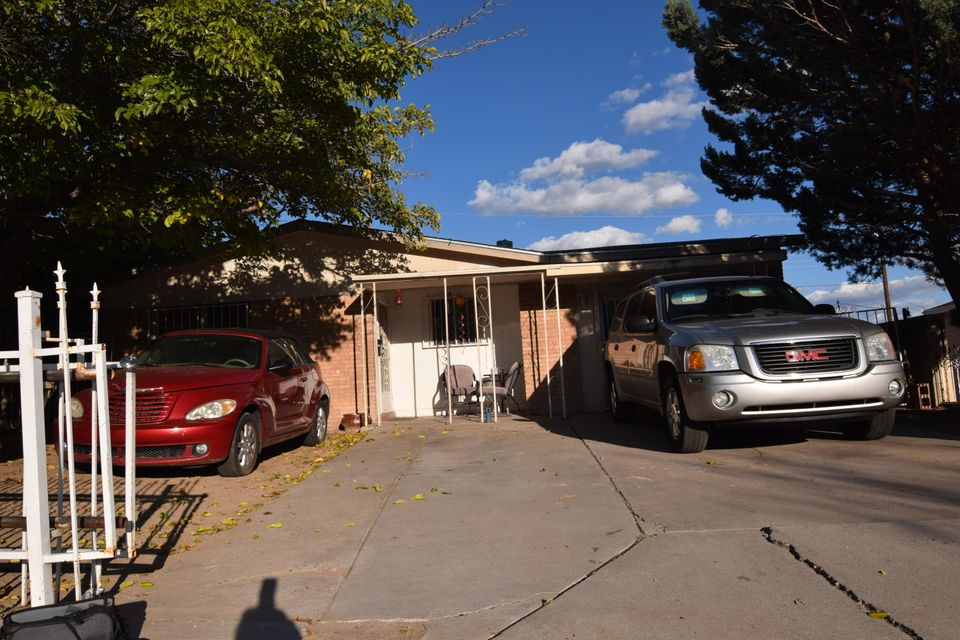 Great starter home adjacent to Central Ave and the new proposed Albuquerque Rapid Transit line.  Newer furnace and water heater less than 10 years old.  Converted garage makes a nice second living area. Will sell fast!