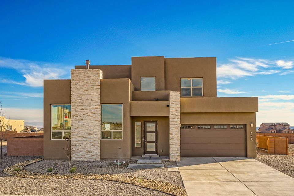 Amazing location within the only walled subdivision in Petroglyph Estates. The VIEWS you have been looking for. This BGNM Silver certified Rhett Ashley home is built to impress. 14' ceilings, 8'doors, and oversized windows in the main living area. The kitchen features GE Profile ss appliances, quartz/granite countertops, large pantry, and a huge island. The master bedroom is on the 1st floor and includes a master bathroom with gorgeous tile detail a stand alone soaking tub and oversized shower. Walk through the master bath to find a large walk in closet with a closet system and access to the laundry room. Upstairs you will find 2 large bedrooms a large bath and an extra living space that opens to a deck with views that will take your breath away.  A must see!