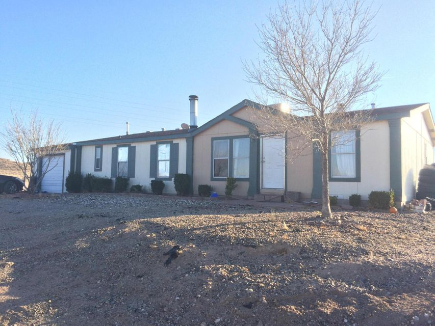 Owner Financing available. This comfortable 3 bedroom 2 bath home sits on a large corner lot featuring an unobstructed view of the beautiful Manzano mountains. It has a large split master bedroom, and an open design with plenty of room for your family activities. On the West side of the Rio Grande in an established neighborhood, the home has a permanent foundation, and a single car garage attached. The huge fenced back yard has plenty of room for your pets. Come and see what this very affordable home has to offer!