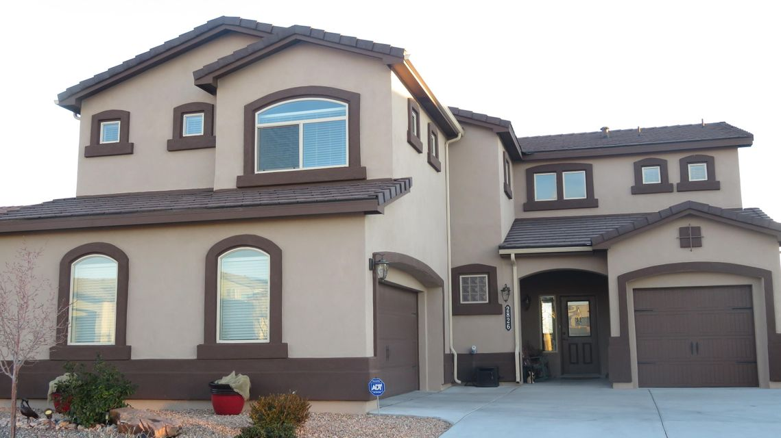 This stunning home features 5 bedrooms/ 3 baths. It has lots of room and boasts 3538 SF. Make a grand entrance in the foyer, stunning dining area, with candle adjustable light fixture, and extra large front room. Every room has its own charm. The kitchen will delight even a gourmet chef with granite counter tops and an island. Amazing pot/pan holder comes with the house. There is a master bedroom upstairs and downstairs. Very open and airy living space. Plenty of storage and closets. Huge walk in pantry and is big enough to put an office in there. Two laundry areas, one upstairs and one in the garage. One set of washers and dryers does not convey but there are hook ups-Upstairs there is a wonderful sitting area, office, or study, you could even make it into another bedroom.