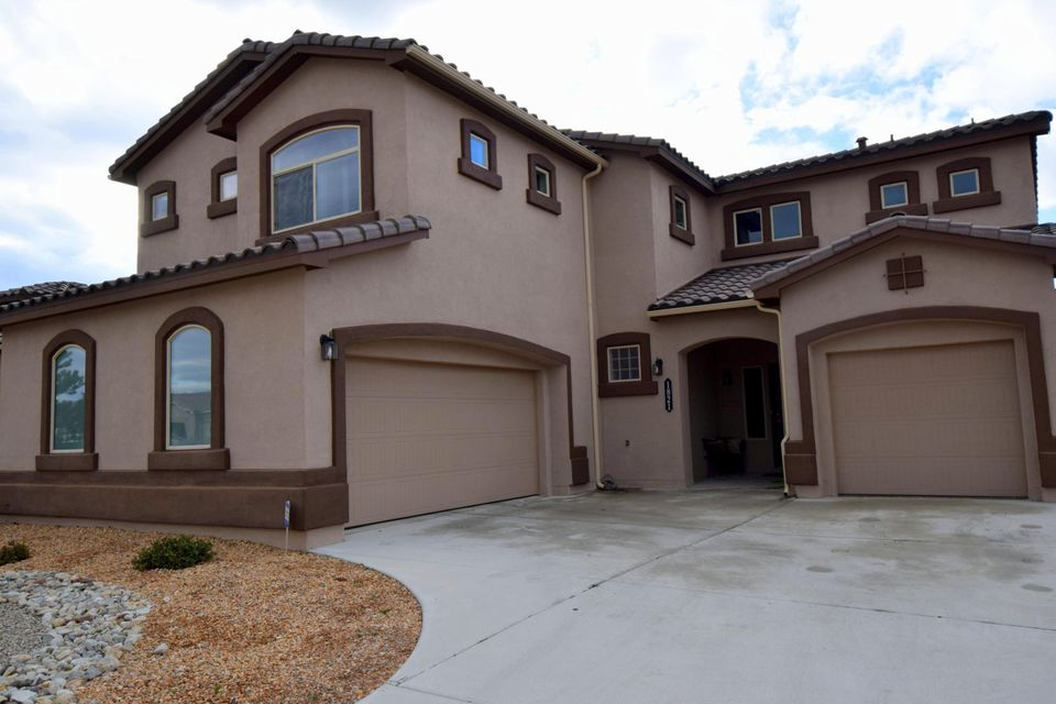 Dr Horton's Exquisite home located in Cabezon's Arbolera Del Este Community. Parks, swimming pool, highly rated Schools & walking trails abound. Dramatically Combining the best traditional detailing w/high tech amenities to provide for the ultimate lifestyle.3302 sqft of sumtuous living space & sought after amenities including, cozy gas fireplace surrounded by Cultured Stone, floor to ceiling patio doors, Professionally landscaped yard front and back, backed to trails/arroyo.functional floor plan kitchen opens to living area/den, enormous Island in kitchen, Granite Countertops & contemporary dark cabinetry,STAINLESS STEEL GE PROFILE APPLIANCES, 18 inch tile, REAL Hardwood floors in Dining & Loft. Extra Pantry storage in large utility room, faux wood blinds, GUEST BEDROOM down w/ 3/4 shower