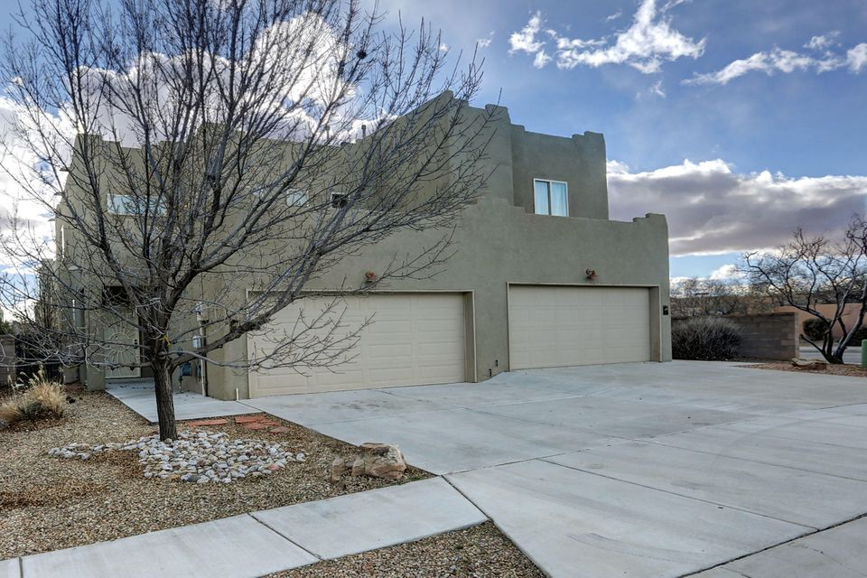 Beautiful home in an ideal location, situated close to the Rio Grande and Bosque, shopping center and restaurants.   Great access to major roads.  This home is move in ready, with beautiful new carpet and paint. Open living area and kitchen, the balcony just off the master suite is a nice retreat.