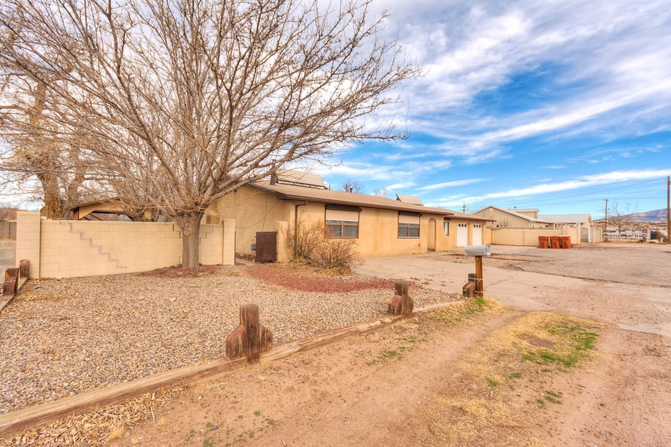 Sprawling single level home in the heart of Bernalillo.  Easy access to I25, located on a large half acre lot with backyard access and a carport.  Perfect for the RV lover! Two car garage features a rear tandem exit for the automotive enthusiast!  The interior has many updates including tile floors, laminate wood, updated kitchen appliances, refrigerated air and many more! This one will not last long!