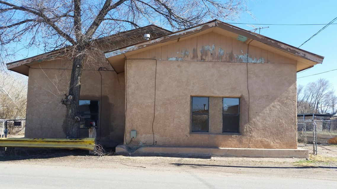 Great location for this Unique home in the heart of town! Approximately 1446sq', 2 possible 3 bedrooms, 1 bath  close to shopping, schools and church, with a big clean fenced in lot.  There is a possible guest house, mother in law suite/workshop in back 600sq 20 X 30, has electrical panel and water it needs work but has potential. There is a well/septic and central heating in front house. Need some work to make it your own cozy nest or use it for rental income. Seller will accept Real Estate Contract under right conditions.