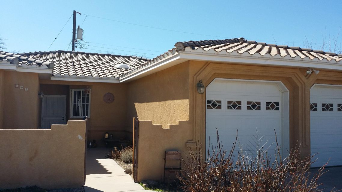 This home is a bank approved Short Sale. This Is A Custom home In The Heart Of The North Valley. Convenient Location On A Private Culd-e-sac. Small courtyard for privacy, storage shed, and a workshop! Vaulted Ceilings & Skylights In The Living Room. The Master Bath Has An Oversized Shower & Jetted Tub.