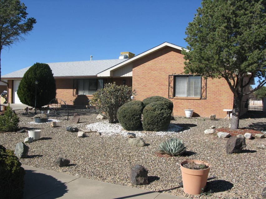 Super home in a fantastic neighborhood!Very sharp brick veneer home in beautiful Enchanted Mesa subdivision in Rio Communities. Spacious home with over 2100 square feet and two living areas. Large lot with two storage sheds.