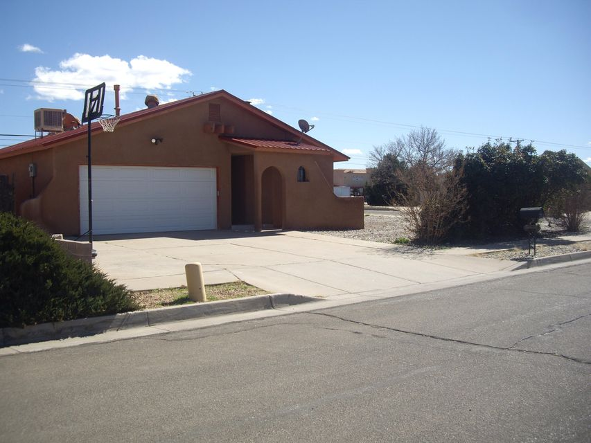 Cozy 3 bed, 2 bath, 2 car garage property located in Albuquerque with easy access to I-25 and the west side features a luxurious corner lot with xeriscape landscaping, RV Parking with room left over for boats and toys. The owners and visitors enjoy watching the Hot Air Balloons launch from the Balloon Fiesta Park.  Interior is well maintained and features 12 x 12 porcelain tile in main living area,  fire place, French doors to back yard, vaulted ceiling, the square footage is utilized nicely.