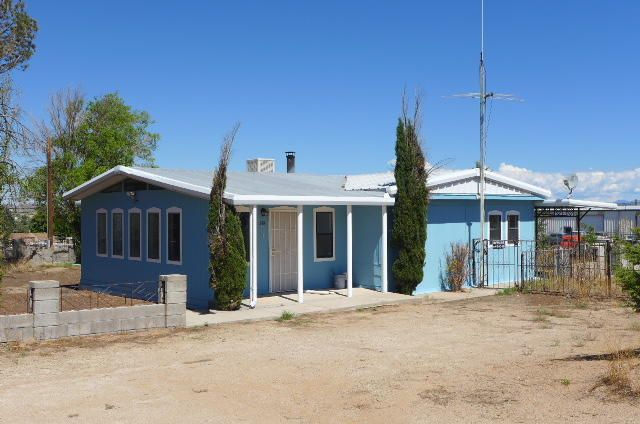 This Three Acre Parcel consist of a Manufactured Home with an addition, Three Bedrooms, 2 Plus Living Areas and 2 Full Baths, This Parcel also include40 X 60 Insulated Garage/Storage Building, additionally a 24 X 46 Storage Building.  This property is Zoned M-1 (Light Industrial) Great Location Backs up to I-25 Freeway,  See attachments for additional information,, Property has 377.3 Linear Frontage Feet on I-25 Just South of Bernalillo Exit.