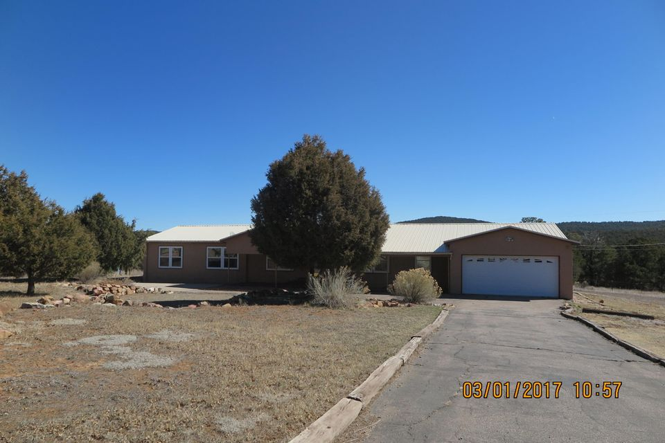 Peace and Quiet living on this rural 1 acre parcel. Large front porch, over sized 2 car garage. Large great room with laminate floors,  Eat in country kitchen w/tile floors, skylights, master suite with soaking tub,double sinks. Ceiling fans, separate utiilty room, thermal windows, grand entry to lot. See attachments for PAS requirements and WFHM offer submittal information in the MLS document section.