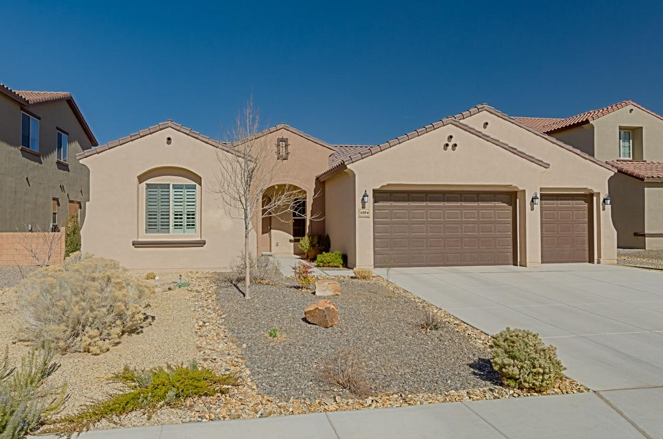 Beautiful large single story in Rio Rancho's premier gated community of Tres Colinas of Loma Colorado. Used as a ''model home'' by Pulte, this Juniper plan is gorgeous! Loaded with upgrades! Love to cook? Stunning chef's kitchen with beautiful cabinetry, tiger eye granite, large island open to great room. Perfect for entertaining with a 16ft multi-panel sliding door to allow access to the outdoor patio. Private owner's suite with luxurious bath. Huge walk in shower, well appointed bath and big walk in closet. Two more bedrooms are separated from the owners suite for privacy. Office/4th bedroom has French doors. Elegant tile floors to wow your guests. Nicely landscaped yard front and back. Large 3 car garage. Best of all, very private street, loacted on a cul de sac. Buy less than new!