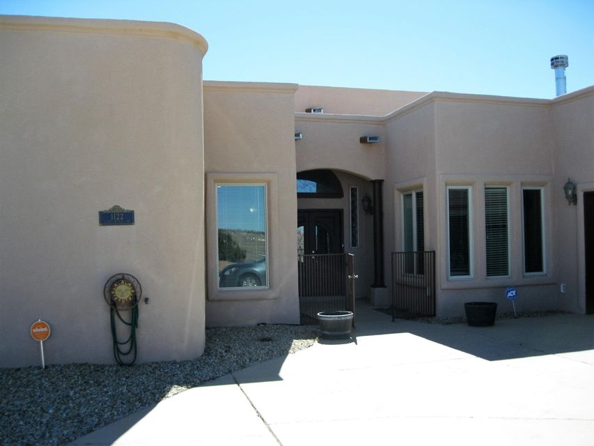 PLENTY OF ROOM TO ROAM! 6 BEDROOMS/4 BATHS/3CAR GARAGE ALL ON A HALF AN ACRE OF PROPERTY!! Beautiful Views of Our Mountains, City, & of the Rio Grande Valley! Convenient Location in the Path of our Beautiful City's Progress!! Located Near our New Hospital, Schools, Restaurants, Shopping Malls & Theatre! This Home has 2 Separated Master/Suites. One of the Mastersuites includes a separate Sauna/Romantic 2-way Gas Fireplace, over-sized Jetted Tub & Dressing area with built-in Amoire & Lighted Make up Mirrors. The Floorplan is Greatroom in Design, Fabulous Kitchen, Multiple Fireplaces, Patios Galore!! 2+ Refrigerated Air Units.. ...Even a SwimSpa!! Sweeeet!!