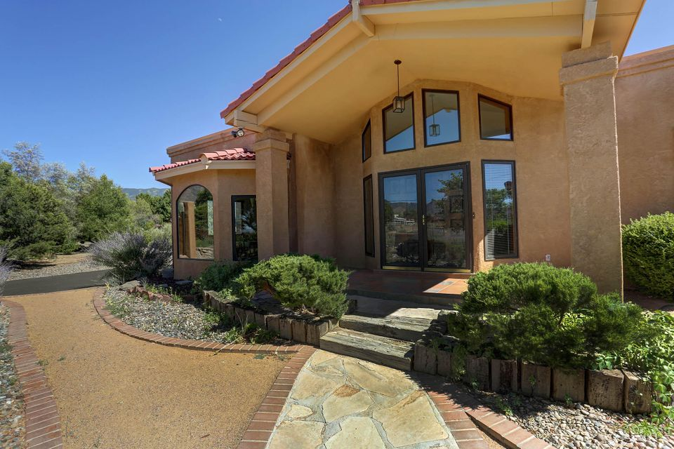 Open house Saturday (07/01) 12pm to 3pm and Sunday (07/02) 11am to 2pm. Best value in North Albuquerque Acres. 4 bedroom, 2 bath with 2 3/4 baths. Upstairs bath has a nice spa shower. Huge kitchen/dining combo room for entertaining. Open deck in the front and in the back of this nice home. The yard is landscaped with fruit and shade trees. Call Annie for your personal showing.