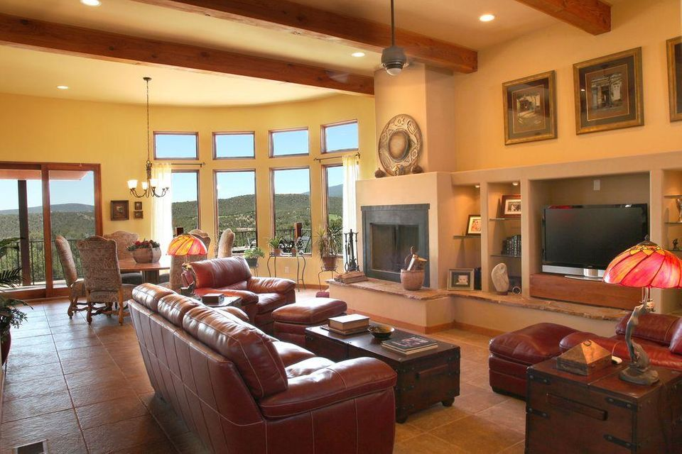 Spectacular 4 br, 3ba custom home in Paako Golf course, million $ neighborhood. 12-15 ft ceilings, 3 fireplaces, granite and stainless kitchen, fam rm with flr to ceiling curved wall of windows - views of Sandia Peak ski area and 3 mtn ranges.  Luxurious mstr bath, heart wood custom walk-in mstr closet.  Salt water pool (no chemicals), 1,000 sq ft trex deck, two pergolas with water features, very private, exc schools. Perfect 4 season home for families or active retirement/2nd home.  35 minutes to ABQ Sunport.