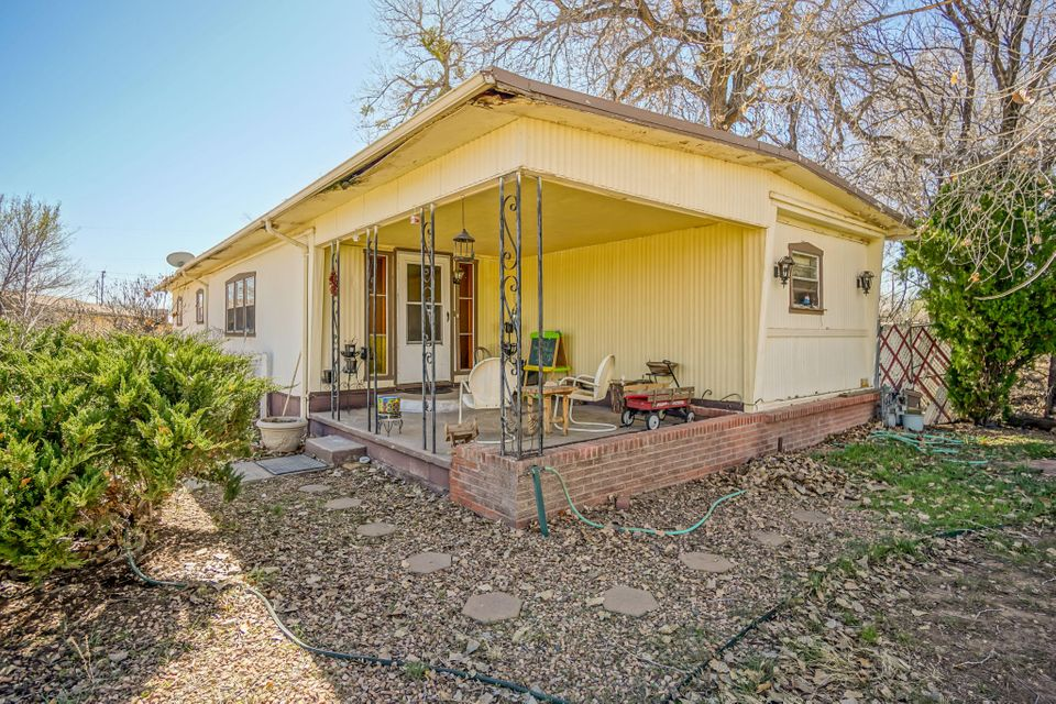 Opportunity knocks! Just under 1 acre in a sedate North Valley cul-de-sac. 2 mobile homes on permanent foundations with rental history.  720 sqft 1 bedroom 1 bath guest house. 3 two car garages/storage outbuildings. Near the arroyo, Rio Grande and miles of lush trails. Use as a rental investment or build your dream home!