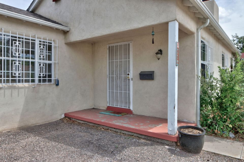 Don't pass this one by!!! Wonderful access to UNM, Nob Hill, parks, airport and freeways. Terrific schools. Under $200K. This is a gem inside. 3 bedroom, 2 bath and 2 living areas.  Kitchen opens onto lovely open family room with patio doors to the outside. Comfortable master bedroom with new 3/4 bath. Baths and kitchen sweetly updated.  Central forced heating, new windows, security bars. Great patio and raised bed gardening areas, New outdoor shed. Short walk to Hidden Park. Huge off street parking area --makes in and out on Carlisle a breeze.