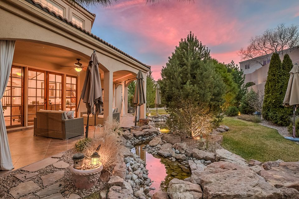 Elegance, quality and privacy at the end of a cul-de-sac with views of the mountains, Bosque & city lights! A magical mix of custom features in an open and flowing floor plan with flex space for guests, in-laws, or amazing play space.Granite counters,apron sink,recent 6 burner gas stove & independent refrigerator and freezer combination.Charming master bedroom tucked into the main floor with elegant bath and clean lined cupboard style master dressing area. Wood floors! Listen to the fountains outside your window as you fall asleep.Patio lives like a room and flows seamlessly with master and the living areas.Main floor den/office in addition to Great room. Each additional bdrm w/private bath and sep from master. Exquisite yard, Pool & beautiful gardens New Refrig air. $150k in improvements!
