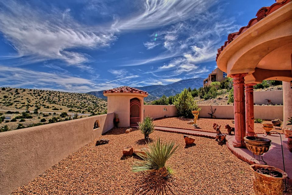 Your Gateway to Incredible, New Mexico Skies! A One owner,Custom! Unobstructed & Captivating Mountain and Mesa Views. Night lights in the distance are also amazing for gazing. Model-like condition inside and out - showcases huge pride of ownership. Multiple living and dining areas, wonderful chef's kitchen with tile,wood,shelving galore.Well separated Master Suite with ''Juliet'' balcony and a View of the Sandia Mountain. An outdoor patio with fireplace and gourmet grill. This home is painted with yellows, rusts, tans to enhance a Tuscan, Southwest, Artsy Lifestyle. Plenty of room for all your artwork, sculpture, decorator accents. Location is convenient,yet private. Small enclave of Custom homes & some of the BEST VIEWS in Placitas. Visit Today, tap our link for the virtual tour NICE!