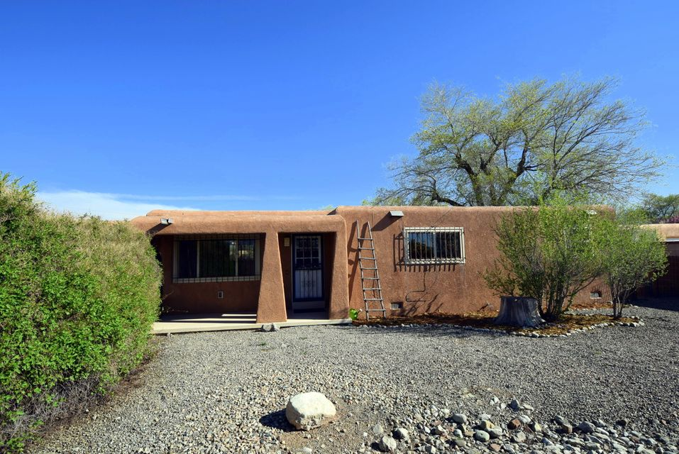 Darling one story pueblo sits on over .3 an acre in the North Valley with easy backyard access.  Home has 2 living areas, fresh paint, newer carpet and tile in kitchen. Main bath has been updated, as well as most windows. Roof replaced in 2010/2011. Enjoy the refrigrated a/c this summer plus 377sq.ft. bonus room not included square footage. Also included is lot next door totaling .63 acre. Wonderful opportunity for investor or buyer who wants NV land at an affordable price.