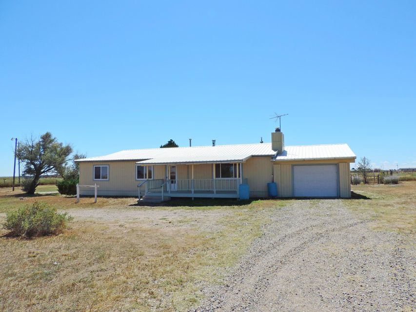 Don't buy a Mobile home when you can have this lovely Site built home on 5 acres for the same price! Live the Country life at this Mini Ranch! Nice floor plan, woodstove heats most of the home, for low utility bills. 5 Acres Completely fenced with Metal Barn and chicken pens. Metal Roof, Newer Septic. New Paint. 1 car garage. Mature Trees. Porches front and back of home. Great place to relax. Right off the pavement, great location, easy access.