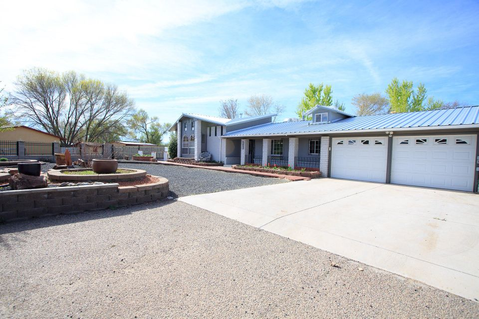 This is a MUST see in Bosque Farms!!  Beautiful country living with SO much charm and extras!! Recently updated, new paint, carpet, newer windows and water heater.  Great room/multi media theater room has raised ceiling, a ''step up'' entertaining area w/game table, refrigerator, microwave gas fireplace and wet-bar. Spacious master bedroom suite with large closet. Bonus room can be used as a 4th bedroom, hobby room or home office. 34X14 screened in patio and there's plenty of room outside for ALL your toys. Attached/oversized 2 car garage w/workshop/office area, additional 2 car carport, 18X24 RV carport, 91X18 RV carport w/roll down door, 10X10 workshop area w/wash sink and BONUS 1/2 bathroom. Beautiful landscaping, low maintenance. Come take a tour of this unique home today!