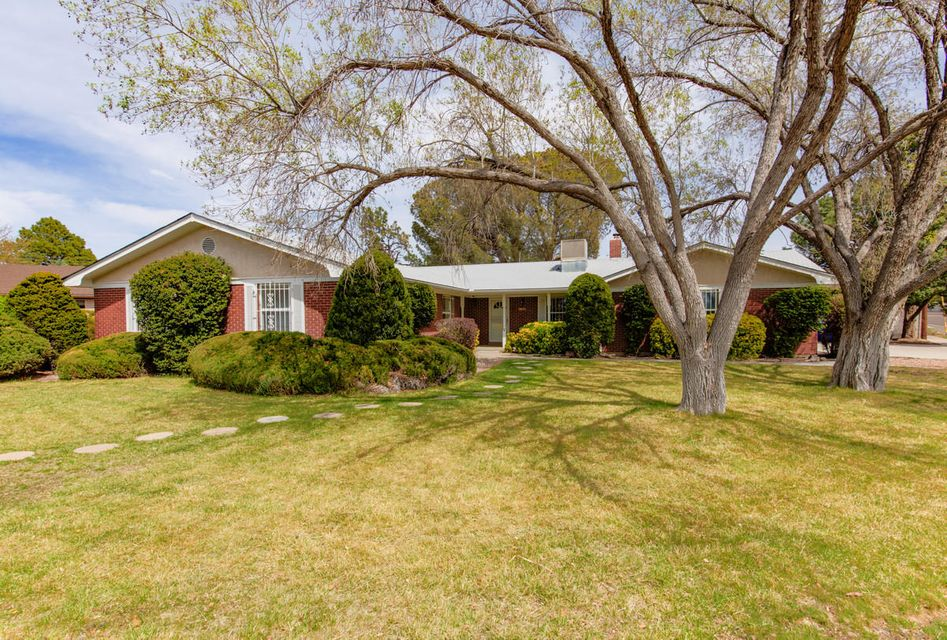 Huge Price Reduction on lovely Mossman!  Many inspections already complete too! Come and see this great opportunity for place and space with almost 2,300 square feet in the heart of the Sandia High School district.  Just blocks to parks and shopping. Amenities await, with updated granite counter tops, refinished wood floors, updated bathrooms, tile, and thermal windows. In addition to four bedrooms and three bathrooms, there's an oversized 2 car garage with a separate workshop, a cedar walk-in closet, an oversized driveway with room for an RV, two large living areas, and storage galore. Huge Corner lot with lush grass  and mature shrubs up front and expansive / private backyard living space with a covered patio and drive through gates.  New roof in 2016.  New price as of May 31, 2017.
