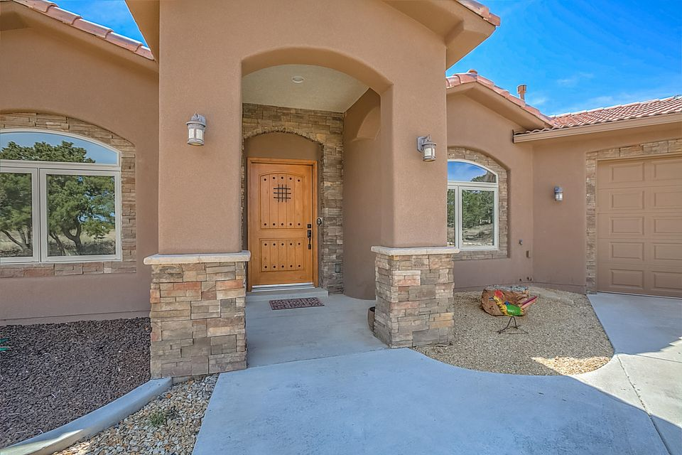 Great single story open floor plan with spectacular views situated on 2 acres. Spacious house offers sprawling master bedroom, oversized master bath and large secondary bedrooms. House has numerous upgrades throughout - JennAir appliances, tile floor, engineered wood, built-in speaker system, electric radiant in master bath, and top down/bottom up cellular blinds. Beautiful stone fireplace with built in energy efficient pellet stove. Great outdoor space for entertaining.  15 minutes to Tramway.  Nature Pointe Community has so much to offer so stop by today and don't forget to visit the clubhouse to see the all amenities you can enjoy.