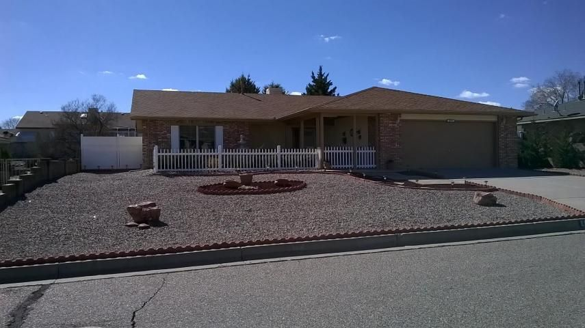 Shows and feels like a model home.Updated; Interior Plumbing, Roof, HVAC, Flooring, Paint, Windows, totally remodeled kitchen with island and quality appliance package, spacious laundry room with sink and storage.Front and Backyard Covered Patios with mountain view from front and rear privacy. Workshop, privacy walls and side yard fencing. Fully landscaped front and back for easy maintenance and great curb appeal. Great location and close to parks, schools & library