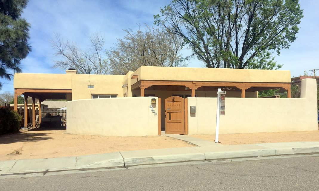 This one is ready for new owner in highly desirable UNM Nob Hill NE area!! Large Foyer greets you (15x9) with skylight, Formal dining, Real Wood flooring with FP, lots of natural light and nice size living quarters. Mexican tile lightens the atmosphere, Hot Water on demand, Recessed lighting,  2 Wood burning fireplaces,  NichosSkylights throughout, Tongue and groove ceiling w beams in living quarters with Kiva FP, clerestory windows and french doors leading you out to your hot tub and large covered wood deck. Large courtyard with outdoor Kiva Fireplace & covered patio for enjoyment of your privacy. More photos to follow..This one will go QUICK!
