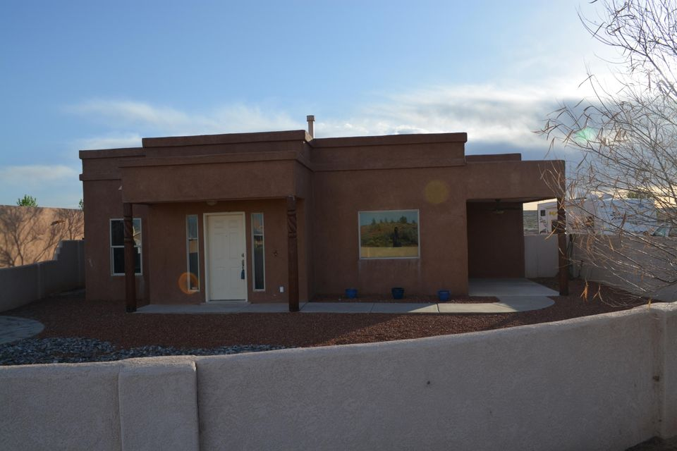 Great views from this beautiful custom home on 1/2 acre lot with custom ceramic tile, 3 way fireplace, spa like master bath, huge walk in closet, oversized garage, granite countertops in the kitchen, 3 covered patios cozy outdoor kiva fireplace with courtyard ready for entertaining and taking in those mountain views.