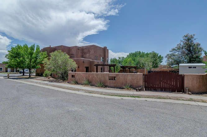 Come see this charming & Spacious Home with an Open Floor plan & breathtaking views of the North Valley & New Mexico Skies from its balconies. This home wraps around the Corner lot sitting on 1/3 of an acre. So many windows which bring in lots of natural light mixed with custom cabinets & built in's for convenience. Entertain guests in the outdoor living space & covered patios w/ side access to backyard(park your RV or Boat). 5 bedrooms total, 2 downstairs ( utilize for office/Guest) w/ 3/4 bath) 3 upstairs each w/bathrooms, Open living area & large kitchen w/island/bar & WOOD FLOORS in formal living, captivating wood tongue & groove ceilings soaring above. 3 fireplaces, radiant heat & newer carpet, Enjoy the good life! SELLER IS OFFERING $10,000 in FLEX CASH w/full price offer, CALL TODAY