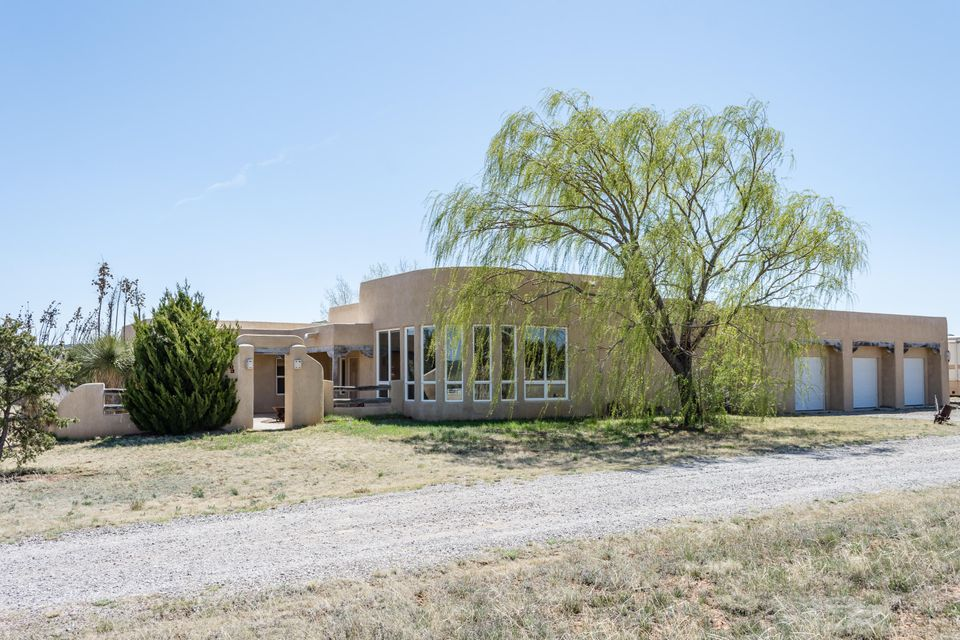 Country Elegance-Custom Casa on 3.63 acres with an Abundance of Amenities! Custom Kiva Fireplace, Beautiful Plastered Walls, Beams/Corbels/Nichos. Spacious Great Room, Gourmet Kitchen with Eating Area. Wonderful Master Suite with Access to The Awesome Back Courtyard w/Custom Kiva FP, Bancos, Grill & Pond. Roof was replaced with TPO in 2014. Third Bedroom had a Murphy bed which can stay or be taken away. This a Wonderful Home to Entertain Inside and Out! There is an oversized 3-Car Garage with Storage. This Home can be Ready for an Immediate Occupancy. Room for Horses and Ready for a New Family to Make Memories In!