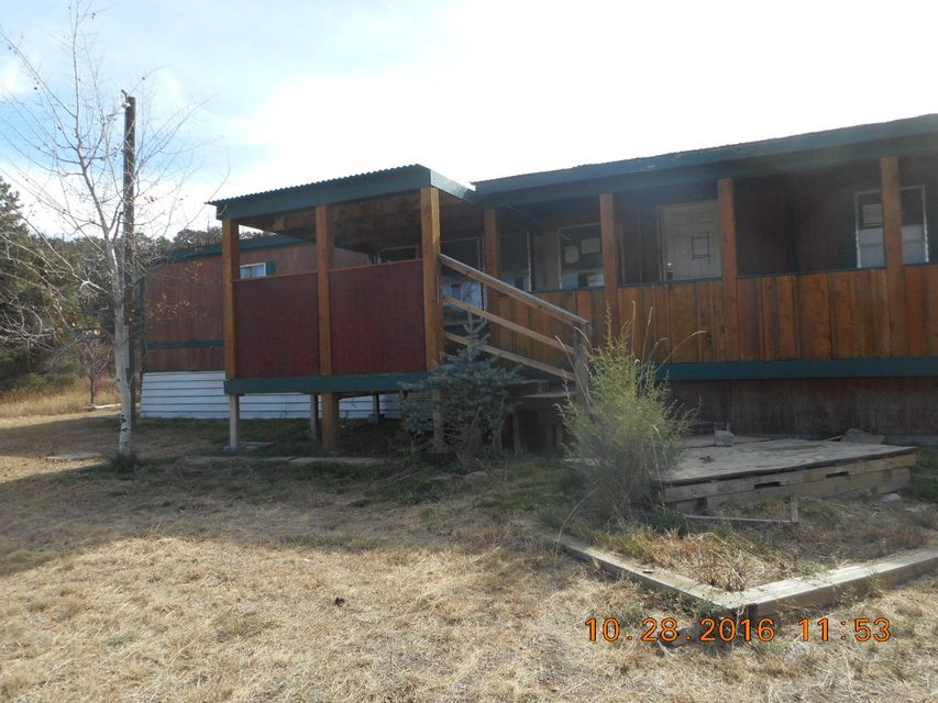 Property is adjacent Riding Trails located on the property is a Barn Stall great to keep at least 2 horses in. Easy access to Edgewood & I40. Great covered porch to enjoy on those cool summer evenings and another great feature is additional storage in the rear of the property.