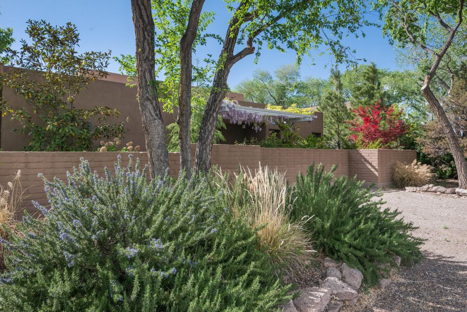 """BEST OF EVERYTHING:  Urban/Country living at its finest.  Master crafted 3,250 sq. ft. home built by John Blueher; close-in North Valley hidden gem in gated 7 home compound designed by William Osofsky; media room/library w gas fireplace; separate living room & formal dining room; spacious master suite, luxury bath w separate shower & bathing pool (""""champagne bubble"""" tub), huge walk-in closet; guest room & study (or 2 more bedrooms); gallery hall; radiant heat, refrigerated air plus forced air heat. Outstanding kitchen design & appliances; matched &booked solid maple cabinetry throughout; bamboo floors; 3 lovely patios with easy care evergreen & perennial landscaping; stacked stone fountain; storage galore.Close to fine and casual dining, museums, bike trails. Freeway access for you."""