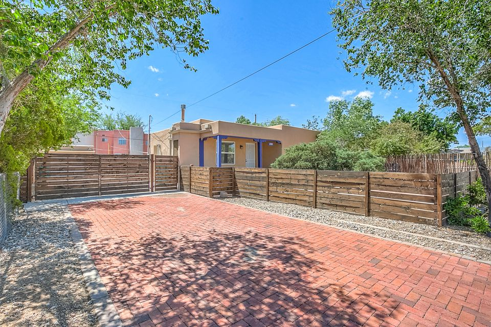 Location, location, location! The convenience of being close to downtown, Old Town, and the Mountain Rd bike trails. This cozy adobe casita has lots to offer. Follow the red brick drive way to your front court yard. The gates can be arranged so you can have continuous access, front & back. In the past few years, the sellers have added TPO roof, Eco-friendly guttering with rain barrels, kitchen sink, water heater, lighting fixtures in some rooms, laminate flooring, bedroom windows, and some painting updates. Also features ADT Home Security System and includes stacked washer/dryer combo and refrigerator. Refrigerated air to keep you cool in the summer. The freshly painted studio is heated & cooled. Full Home Inspection completed. Don't miss out!