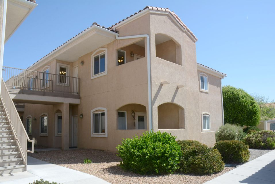 This three bedroom, two bath condominium is in the Rancho Mirage gated community. It is a second story unit located in a four-plex. The spacious living room is adjacent to the kitchen and dining area. The living room opens to a covered patio with a wonderful view of the Sandia Mountains. The large master suite features a walk-in closet and the bathroom has an over-sized shower and dual sinks. Each bedroom has a ceiling fan. All kitchen appliances convey with the property. There is a separate utility room equipped with cabinet space and a washer and dryer. The condo has its own detached single car garage and an additional designated parking space, both of which are in close proximity to the unit. It is very clean, has new carpet and is move-in ready! Great location/close to I-25.