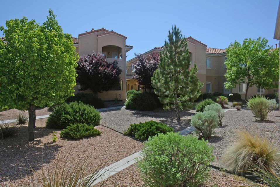 This three bedroom, two bath condominium is in the Rancho Mirage gated community. It is a second story unit located in a four-plex. The spacious living room is adjacent to the kitchen and dining area. The living room opens to a covered patio with a wonderful vista view of the Sandia Mountains. The large master suite features a walk-in closet and the bathroom has an over-sized shower and dual sinks. Each bedroom has a ceiling fan. All kitchen appliances convey with the property. There is a separate utility room equipped with cabinet space and a washer and dryer. The condo has its own detached single car garage and an additional designated parking space, both of which are in close proximity to the unit. It is very clean, has new carpet and is move-in ready! Great location/close to I-25.