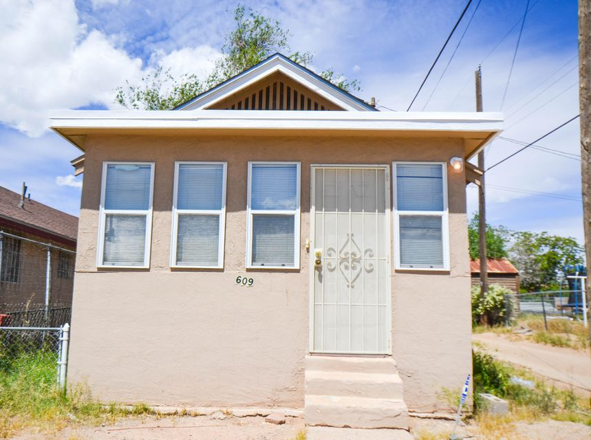Super Cute 1 bed, 1 bath bungalow! This charming home has 2 living areas. There is also a quaint yard. Enjoy easy access to Downtown, UNM, Nob Hill and the freeway. All that's missing is you!
