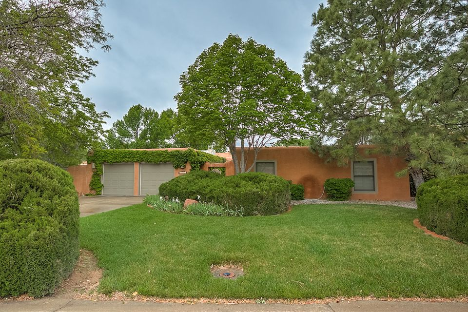 Wonderful single story 4 bedroom home in a tranquil North Valley setting.  Lush corner lot is framed by fruit trees, roses, garden areas and fountains.  Covered patio back and side - amazing outdoor spaces.Clean living interiors - large master with walk-in closet and built ins; 3 spacious guest rooms, one that opens to courtyard would make a perfect home office!  Open kitchen with storage spaces, breakfast nook, and service room with 1/2 bath.  Plantation shutters throughout the home.This neighborhood is adjacent to coop grocery and north valley shops.  You will love this neighborhood!