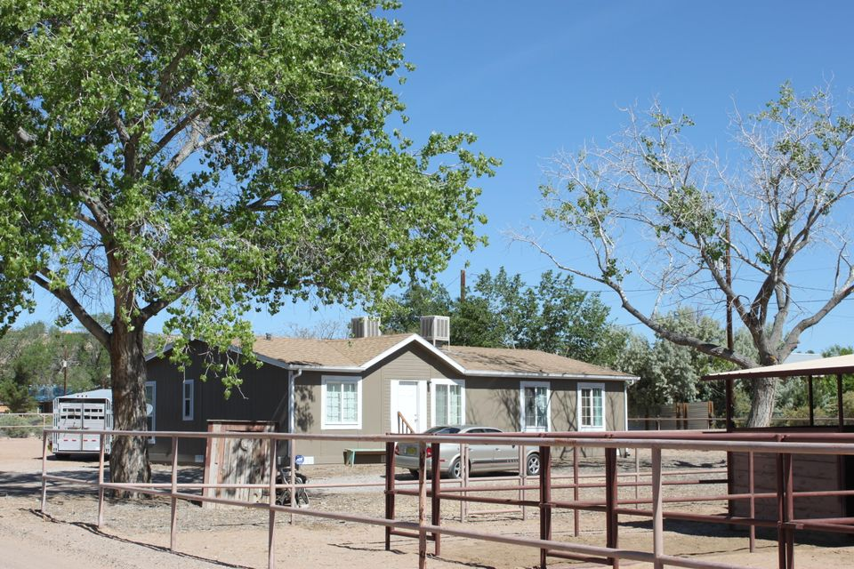 Beautiful remodeled manufactured home that sits on an acre of land in Corrales.  This property has an 8 horse stable with an oversized equipment canopy.  Great views of the Sandia Mountains from the living room.  Come see this wonderful beauty!