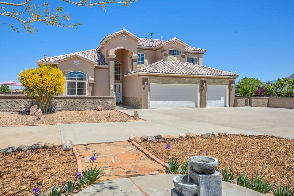 This magnificent lovely home has views that will take your breath away.  Completely remodeled with spectacular touches. The entire family will have all the privacy they want in this spacious and awesome home. Three levels resting on one full acre in the custom home area of Rio Rancho Estates. The kitchen is a chef's delight. With granite counters, stainless higher end appliances, six burner gas range and custom Fonata-Cherry cabinetry, you will enjoy cooking up culinary delicacies. Two spacious master suites. One upstairs and one on the main level.The upstairs master has a giant walk in closet.  When you enter the formal living room you will be greeted with tongue and groove soaring ceilings. Hardwood floors of Acacia wood grace this spectacular room. This lovely room also has a warm and