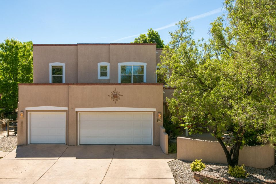 Beautiful Centex custom model home on a large cul-de-sac lot in one of the most highly desired neighborhoods in Albuquerque. This highly customized beauty is a one-owner entertainment 'resort' perfect for the active family. swimming pool, custom spa, custom island grill, 2 distinct patio areas, including 2 Kiva fireplaces.  Two Master Coolers, radian heat throughout, 2 gas water heaters. pre-wired central entertainment system icludes: in-wall speakers in L/R, family room, back patio, pool side island grill, area with individually controlled  volumes.Open concept kitchen with granite countertops and family room. Vaulted ceilings, custom vigas, ceiling fans. MBR with balcony,  Much more! Will consider REC.