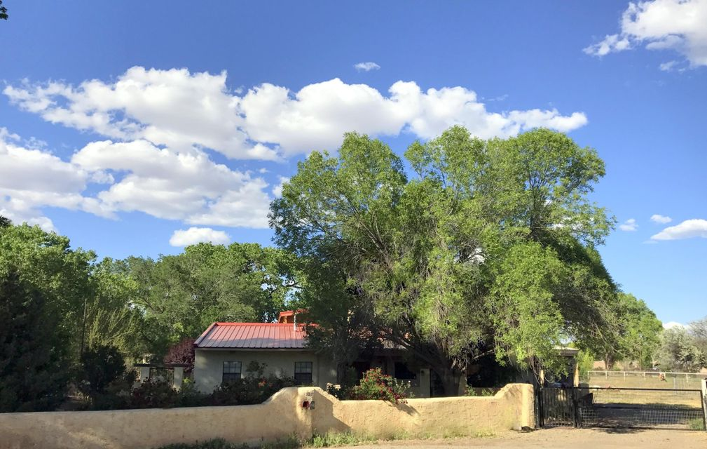 Just over 1.53 Acres, on a Quiet Cul-De-Sac sits this Well Taken Care Of 3,193 ft2 New Mexican Hacienda. Tall, Beam Ceilings & Large Windows allow the Natural Light to Pour in. Custom Touches & Wooden Accents Throughout. Open Floorplan w/ welcoming Foyer, Large Living Room w/Wet Bar & Formal Dining Room. 3 Bedroom Home + Office, 2 Master Suites. Up the Hand Carved Wooden Staircase you will find the Upper Level Master Suite w/Walk-In Closet, Spacious Master Bath & Private Covered Balcony. 2 Refrigerated Air Units & Newer Pro-Panel Metal Roof. HUGE 2,240 ft2 shop/barn. Park your large Horse Trailer/RV/Boat out of the elements, + covered parking for 4 vehicles. Livestock Paddocks. Access on both ends of property. The Possibilities w/ this Property are Endless! Definitely a Must See
