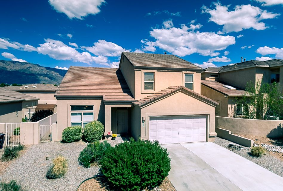 Awesome Charter Home in La Cueva Village! Excellent floorplan - big living room/dining room combination, oversized family room with gaslog fireplace AND large loft/office! Open kitchen with plentiful cabinets & counter space + walk-in pantry! Three bedrooms includes huge master bed & bath with separate tub & shower + walk-in closet. Slate-tiled floors + freshly cleaned carpets! Nice touches like nichos, bookshelves and cathedral ceiling. Easy-care front yard + big backyard with lawn and patio. Double garage. Sweet neighborhood in a super northeast location close to mid- and high schools, shopping (Trader Joe's!) and restaurants.