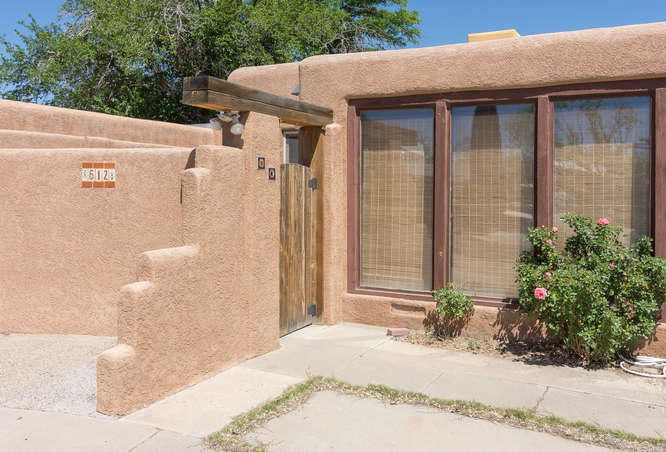 612 and 612 1/2 Simply spectacular unusual opportunity to own a home and lease one at the same time. Or have a separate unit for guests, extended family, or student. 1400 sq ft duplex w/900 sq/ft front apt. Big yard w/freestanding storage shed.Home is quiet and cozy.Front unit has 2 living areas or use one as a second bedroom. Main unit is 2 bedrooms and fabulous family room with fireplace.  Walk or ride a bike to UNM.  NearHospitals, & Nob Hill. Residential neighborhood.  90 sqft Sunroom isn't counted in total square foot, neither is vestibule for main house. Private entrys and gated courtyards lend grace and privacy. These properties are truly  unique opportunities.