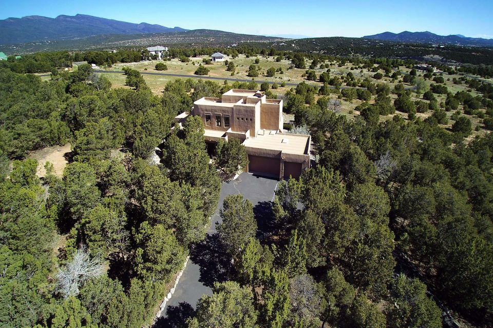 Just 15. Minutes to Albuquerque you can live in a gated community in the east mountains.  with private easement to the National Forrest trails. This tranquil setting also offers a perfect floor plan.  2 living areas adorn this private, light bright  & completely remodeled home since 2013.  Newer stainless appliances in kitchen, 5 burner induction grill, convection oven,  Halbert custom cabinets with tons of pull outs, gorgeous Seafoam granite countertops, cozy kitchen nook, + bar for seating,  built in desk,  and pantry.   Newer wood floors, newer carpet, all new lighting & bathroom mirrors. New roof in 2016. Oversized 3 car garage, perfect cul de sac lot with amazing views. Paved roads and easy comute make them home a must to see.