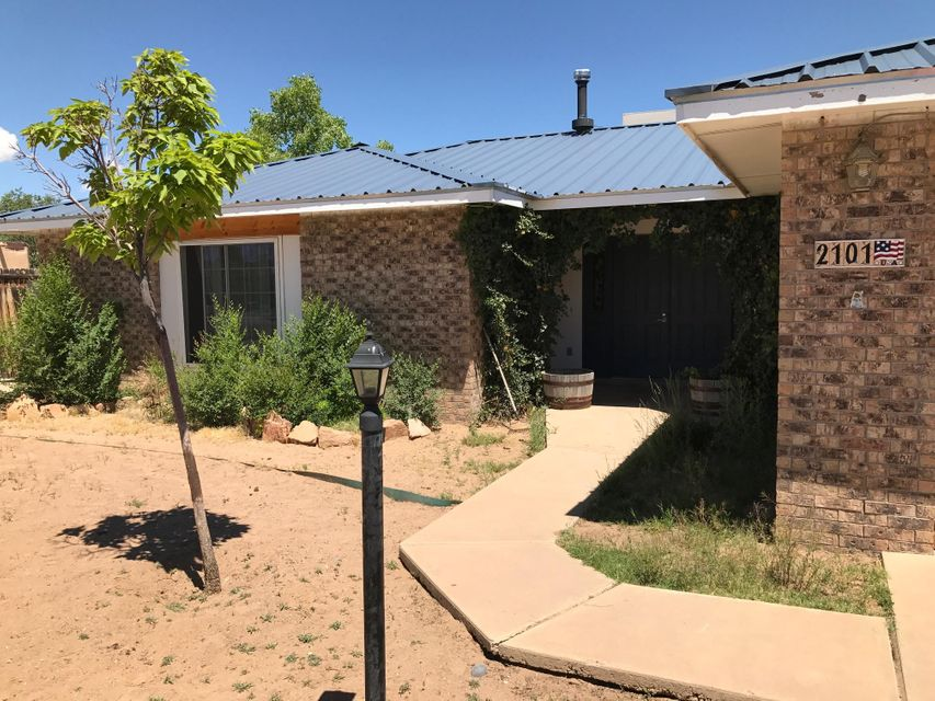 Great opportunity for open floor plan with large covered patio and backyard access on both sides. Many great updates with newer windows, metal roof and bonus room. Come see updated SW landscape in front yard. Stucco repairs are in progress. Great Rio Rancho neighborhood and features 3 Bedrooms, 1 3/4 Baths, and a 2 car garage on large .28 acre lot with additional storage. Come make this beautiful home yours today!
